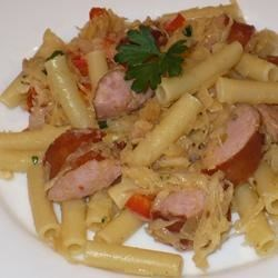 Pasta with Kielbasa and Sauerkraut Recipe - Ziti tossed with kielbasa, sauerkraut, onion and bell pepper and spiced with a bit of mustard and cayenne.