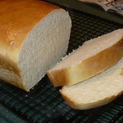 Milk Bread Recipe - The bread machine proves its worth with this basic white bread that calls for a glass of milk.