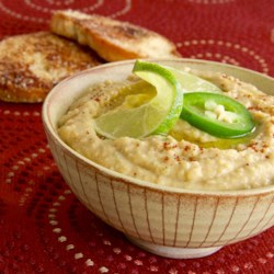 Thai Hummus Recipe - Thai-inspired hummus made with curry paste, lemon grass, Thai basil, and peanut butter is a great way to fulfill your Thai food cravings. Serve with bell pepper strips.