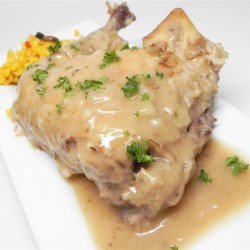 Drunk Chicken in Gravy Recipe - Chicken is simmered in a beer-based gravy with bacon and onion in this cross between coq au vin and beer-can chicken.