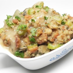 Quickest Oyster Dressing EVER!  Recipe - This quick and delicious oyster and cornbread dressing takes the fuss and the mess out of the picture.  It is all done on the stove top, and tastes like it has been cooking in the oven all day!