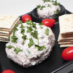 Devilish Cheese Ball Recipe - Every one loves this! Ham meat spread and olives really liven up the usual cheese ball ingredients. Serve with crackers.