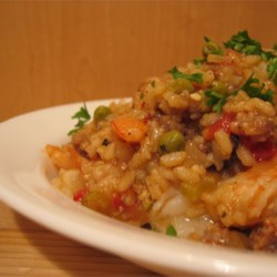 Paella Recipe - A traditional spiced dish made in a wok. The sausage, chicken and shrimp blend nicely with the herbs and spices, and there is plenty to go around.