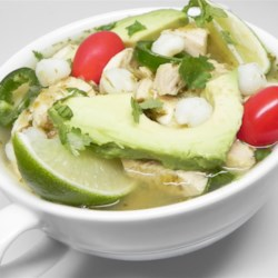 Chicken Posole Verde Soup Recipe - A spicy salsa verde is simmered with shredded chicken and hominy in this gluten-free Mexican-inspired posole soup.