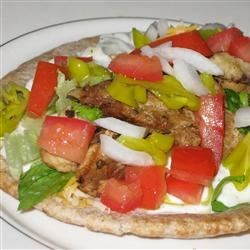 Chicken Souvlaki Gyro Style Recipe - An easy and delicious way to recreate your favorite Greek restaurant dish at home. This Mediterranean-flavored recipe can be served buffet-style allowing your guests to make their own.