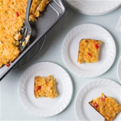 ORE-IDA Sweet Heat Corn Casserole Recipe - Chipotle chile powder brings a touch of heat to this easy, creamy, cheesy corn casserole with hash brown potatoes.