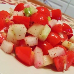 Fresh Israeli Salad Recipe - This Israeli salad, made by tossing cucumbers, bell peppers, and radishes in olive oil, sumac, and lemon juice is a fresh way to enjoy lunch.