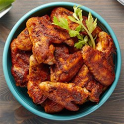 Ranch Buffalo Wings Recipe Recipe - Chicken wings dipped in spicy melted butter and topped with Hidden Valley(R) Original Ranch(R) Salad Dressing & Seasoning Mix are baked then served with prepared ranch dressing and celery sticks.