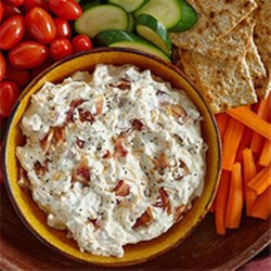 Hidden Valley Bacon & Cheddar Dip Recipe - This creamy, cheesy dip with Hidden Valley(R) Original Ranch(R) Dips Mix and lots of crumbled bacon makes a party-pleasing favorite.