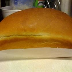 Bagel Bread Recipe - This is a giant bagel in the shape of a loaf of bread -how clever!  The bread machine makes combining the flour, yeast, milk and egg a snap.