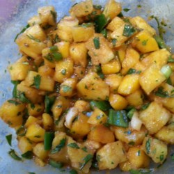 Pineapple and Mango Salsa Recipe - This DIY salsa recipe eschews tomatoes in favor of pineapple and mango, flavored with the usual suspects: jalapeno, onion, and lime juice.