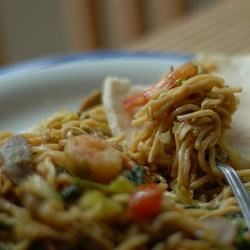 Mie Goreng - Indonesian Fried Noodles Recipe - Chicken breast, cabbage, carrots, broccoli and mushrooms are stir-fried in a wok with cooked ramen noodles and sweet soy sauce to make a beloved home-style Indonesian noodle dish.