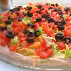 Taco Dip I Recipe - This is a scrumptious taco dip. When I use all low-fat ingredients, such as low-fat sour cream and low-fat Cheddar, it still comes out so delicious! Serve with baked tortilla chips for dipping.