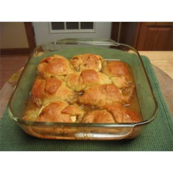 Grandma's Apple Dumplings Recipe - This is a simple and delicious recipe for apples wrapped in dough with an orange vanilla sauce. Don't forget the ice cream!