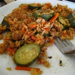 Zucchini Saute Recipe - Another pretty dish. Tomatoes, green pepper and zucchini are sauteed until tender and their flavors have mingled. Rice and water are stirred in and everything is cooked until the liquid is absorbed and the rice is fluffy.