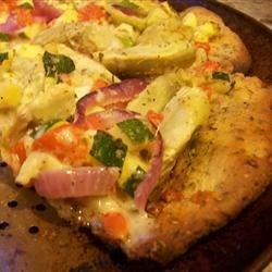 Muffaletta Pizza Recipe - This baked New Orleans style appetizer pizza is topped with exciting ingredients, including a delicious, spicy olive salad, deli meats and cheeses.