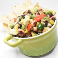 Quick Corn and Bean Salsa Recipe - This salsa-inspired mixture of tomato, avocado, cilantro, beans, and corn makes a great potluck dip.