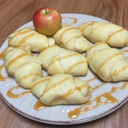 Caramel Apple Blossoms Recipe - Crescent roll dough is wrapped around apples and caramel sauce in these quick and easy caramel apple blossoms the kids will love.
