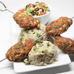 Turkey Kofta Kabobs Recipe - This recipe for kofta, or giant Persian meatballs, combines turkey with the traditional flavors of cilantro, chile, coriander and paprika.