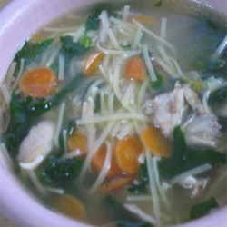 Super Easy Chicken Noodle Soup Recipe - Boneless, skinless chicken breast cooked in chicken bouillon is cut into bite-sized pieces and returned to the broth with thin egg noodles in this easy-to-prepare soup.