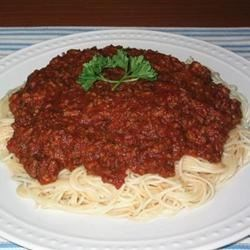 Best Spaghetti Sauce in the World Recipe - Fresh Roma tomatoes, dry vermouth, garlic, and chicken stock are the base of this simple, flavorful sauce. Garnish with a few sprigs of fresh basil.