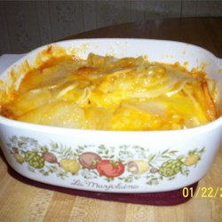 Cheesy Potatoes Recipe - Cheesy potatoes make an easy side dish when you use the microwave. All you need are potatoes, onion, and Cheddar cheese.