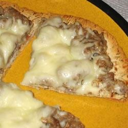 White Pizza Recipe - Sausage and Alfredo pizza. So good you won't believe just how easy it is to make! It's kind of messy to eat, but totally worth it.
