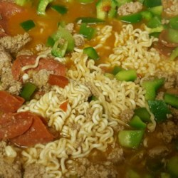 Beefy Italian Ramen Skillet Recipe - This skillet meal combines instant ramen with ground beef, pepperoni, bell pepper, tomatoes, and mozzarella cheese.