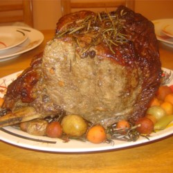 Prime Rib Roast Recipe - A really peppy two-hour marinade, which includes grated fresh ginger, orange marmalade, dry mustard, and beer flavors and tenderizes this roast. It serves 10 to 12, so have a party.