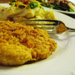 Famous Butter Chicken Recipe and Video - Chicken breasts are dipped in beaten eggs and cracker crumbs, then baked with butter. These chicken breast are really tender and moist. Excellent flavor! I never have leftovers.