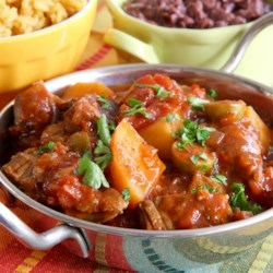 Slow Cooker Spanish Beef Stew Recipe - Try this Spanish-style beef stew made with sofrito, olives, potatoes, tomatoes, garlic, and onion in your slow cooker.