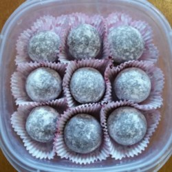 Rum Balls Recipe - Dark rum, chocolate, and vanilla wafers combine for a boozy holiday rum ball that everyone will insist you bring to parties.