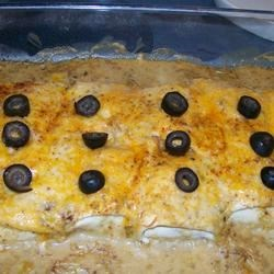 Bean Burrito Casserole Recipe - I usually keep frozen burritos stocked in my freezer just for this recipe.  It's so quick and easy, and tastes delicious.  Can be served with tortilla chips and a salad.  Or double the sauce, and serve over rice.
