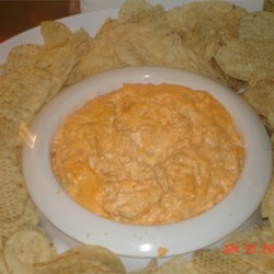 Chicken Wing Dip Recipe and Video - This spicy baked dip tastes just like hot chicken wings, but without the mess.  It is very addicting, and is perfect for football and tailgating season. Serve with tortilla chips. I take this whenever I have to bring a dish and am always asked for the recipe.