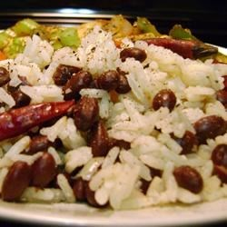 Coconut Rice with Black Beans Recipe - Jasmine rice and minced shallots are simmered with coconut milk then mixed with black beans in this versatile side dish.