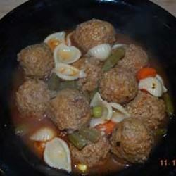 Meatball Soup Recipe - You must already have frozen meatballs on hand for this recipe (no instructions are provided for preparing the meatballs).  The meatballs are added to a herb and tomato base soup with carrots, celery, and elbow macaroni.