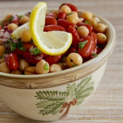 Middle Eastern Bean Salad Recipe - Kidney and garbanzo beans are tossed in a homemade garlic dressing creating a tasty Middle Eastern-inspired salad that is quick and easy to prepare.