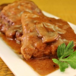 Baked Fake Steak with Gravy Recipe - This is an easy, simple and good recipe that makes a lot. The patties need to chill several hours, so this is good to mix one day and bake the next. Goes well with noodles, rice or mashed potatoes.