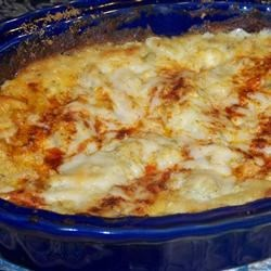 Yummy Artichoke Dip Recipe - This Parmesan cheese dip is a flavorful favorite. Green chile peppers add a spicy thrill!
