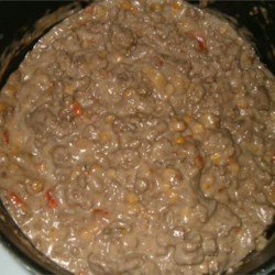 Goulash II Recipe - This simple dish of ground beef, mushroom soup and vegetable soup will have you eating in just minutes. Serve over rice or noodles.