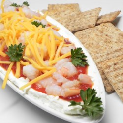 Shrimp Delight Recipe - Layers of cream cheese, cocktail sauce, shrimp and Cheddar cheese make one tasty dip. Bring a cracker and get busy!