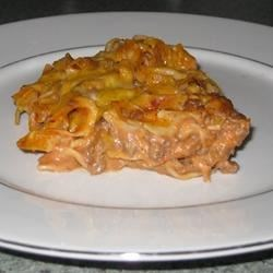 Mrs. Strong's Casserole Recipe - Egg noodles are baked with beefy tomato sauce and a creamy mixture of cream cheese and sour cream.