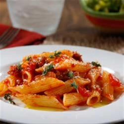 Gluten Free Penne with Spicy Italian Sausage Ragout Recipe - Your whole family will love this delicious blend of spicy Italian sausage ragout and thyme served with Barilla Gluten Free penne pasta.