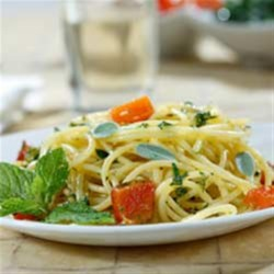 Gluten Free Spaghetti with Diced Potatoes, Roasted Peppers & Aromatic Herb Pesto Recipe - A delicious blend of roasted peppers and diced potatoes are tossed with gluten free spaghetti and an aromatic herb pesto.