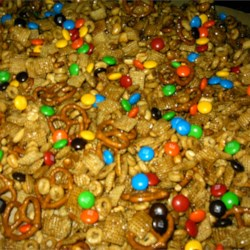 Sweet Party Mix Recipe - Crispy cereal, almonds, and pecans are coated with a sweet, buttery mixture that's sure to please!