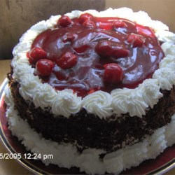 Black Forest Cake I Recipe - This recipe delivers a classic version of the original Black Forest cake with whipped cream frosting and cherry toping.