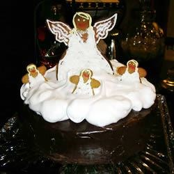 sour cream chocolate cake with meringue topping and gingerbread angels