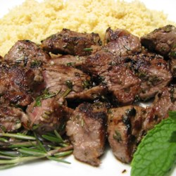 Summer Lamb Kabobs Recipe - Lamb and garlic go so well together. In this recipe, the combination of herbs and spices complement the meat and make an awesome treat for friends and family.