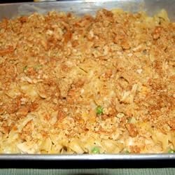 Chicken Noodle Casserole II Recipe - Convenient and economical, this dish combines chicken with vegetables and noodles in a cream sauce, snug under a Monterey jack cheese and bread topping.