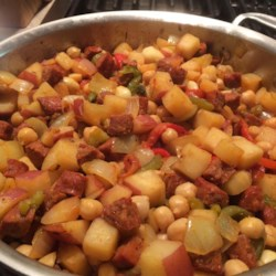 Chickpeas and Chorizo Recipe - This stew recipe is an expansion on a classic Spanish tapas recipe, delivering chorizo, chickpeas, potatoes, and roasted peppers to your dinner table.